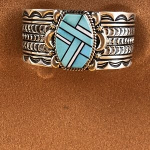 Beautiful heavy Sterling Silver cuff bracelet with intricate hand tool work and Inlayed Sleeping Beauty Turquoise and White inlay by Charles Johnson