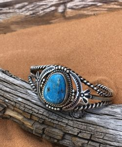 Kingman Turquoise set in an intricate Sterling Silver cuff bracelet