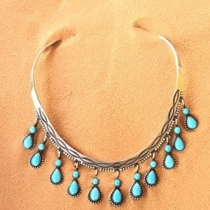 Handmade Navajo Sterling Silver neck collar with satin antique finish, hand tooled, with eleven fine Sleeping Beauty Turquoise drops. Made and signed by renowned silver smith: Herman Smith