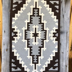 "Genuine Navajo Rug Weaver: Ruth Henry Area: Two Grey Hills Size: 45"" x 27"""