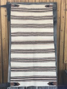 Genuine Navajo Rug Weaver: Betty Black Area: Navajo Saddle Blanket Pattern Size: 63