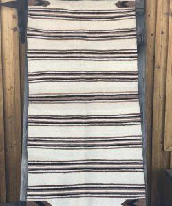Genuine Navajo Rug Weaver: Betty Black Area: Navajo Saddle Blanket Pattern Size: 63